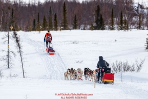 Mitch Seavey passes an Iditasport walker Beat Jegerleheron the trail just prior to the checkpoint at Iditarod on Thursday, March 8th during the 2018 Iditarod Sled Dog Race -- AlaskaPhoto by Jeff Schultz/SchultzPhoto.com  (C) 2018  ALL RIGHTS RESERVED