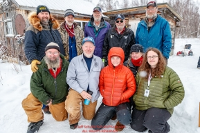 Volunteer checkers, helpers and comms pose for a group photo at the Iditarod checkpoint on Friday, March 9th during the 2018 Iditarod Sled Dog Race -- AlaskaPhoto by Jeff Schultz/SchultzPhoto.com  (C) 2018  ALL RIGHTS RESERVED