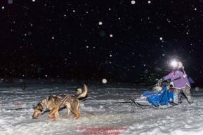 Marcelle Fressineau runs on the trail in the early morning hours as she arrives at the ghost-town checkpoint of Iditarod on Saturday, March 10th during the 2018 Iditarod Sled Dog Race -- AlaskaPhoto by Jeff Schultz/SchultzPhoto.com  (C) 2018  ALL RIGHTS RESERVED