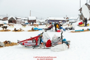 Matt Hall runs through the dog lot on his way through the Kaltag village checkpoint on Sunday morning March 11th during the 2018 Iditarod Sled Dog Race -- AlaskaPhoto by Jeff Schultz/SchultzPhoto.com  (C) 2018  ALL RIGHTS RESERVED