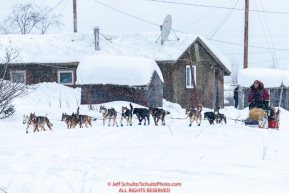 Aaron Burmeister runs down the road as he leaves the Kaltag village checkpoint on Sunday morning March 11th during the 2018 Iditarod Sled Dog Race -- AlaskaPhoto by Jeff Schultz/SchultzPhoto.com  (C) 2018  ALL RIGHTS RESERVED