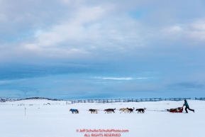 Anna Berington runs on the Kouwegok slough shortly after leaving the Unalakleet checkpoint on Monday  afternoon March 12th during the 2018 Iditarod Sled Dog Race -- AlaskaPhoto by Jeff Schultz/SchultzPhoto.com  (C) 2018  ALL RIGHTS RESERVED